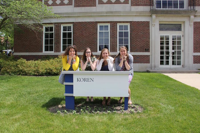 Luther education students with Koren sign.