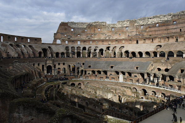 "A bit of sun bursting through the clouds onto the walls of the Colosseum. Photo by Isaac Heins '18.<a href=""/reason/images/801649_orig.jpg"" title=""High res"">∝</a>"