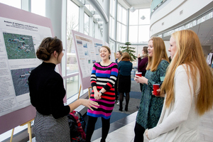 Students presenting their research at the Environmental Studies Poster Session.
