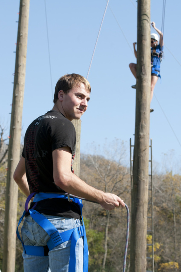 A student works the belay for the course.