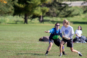 A Freya team member prepares to throw the frisbee.