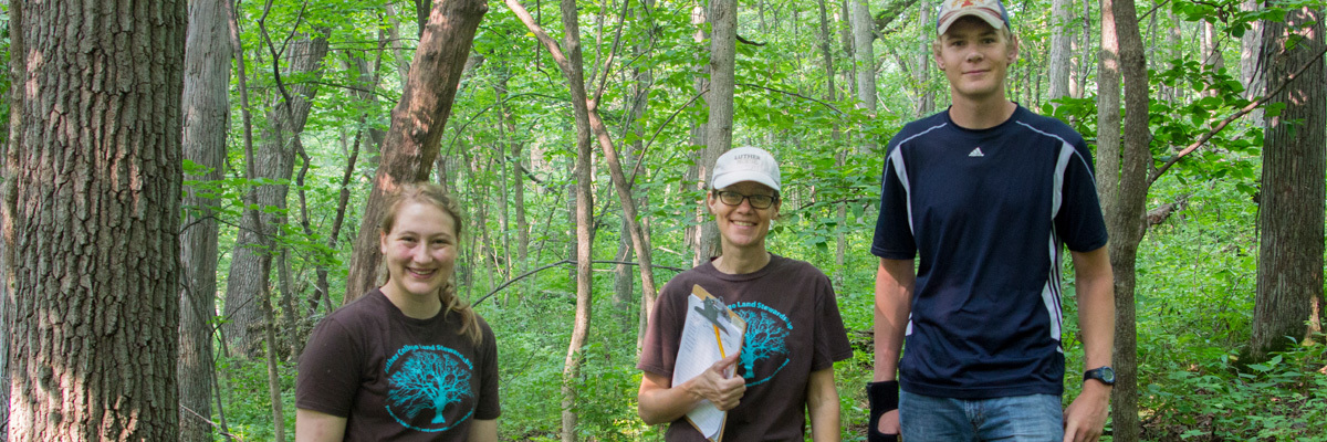 Land Stewardship interns Marissa Wales and Brennen Reysack head out with natural areas land manager, Molly McNicoll, for research data collection in Flying Squirrel Woods.