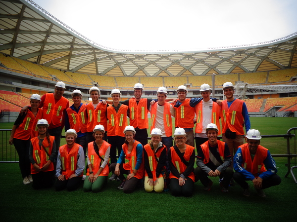 "Our little hardhat family in Arena Amazonia. Four World Cup games will be played here, and one will be USA against Portugal!<a href=""/reason/images/527666_orig.jpg"" title=""High res"">&prop;</a>"