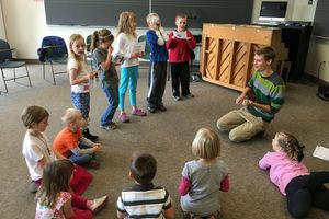 Music education student works with students in area school.