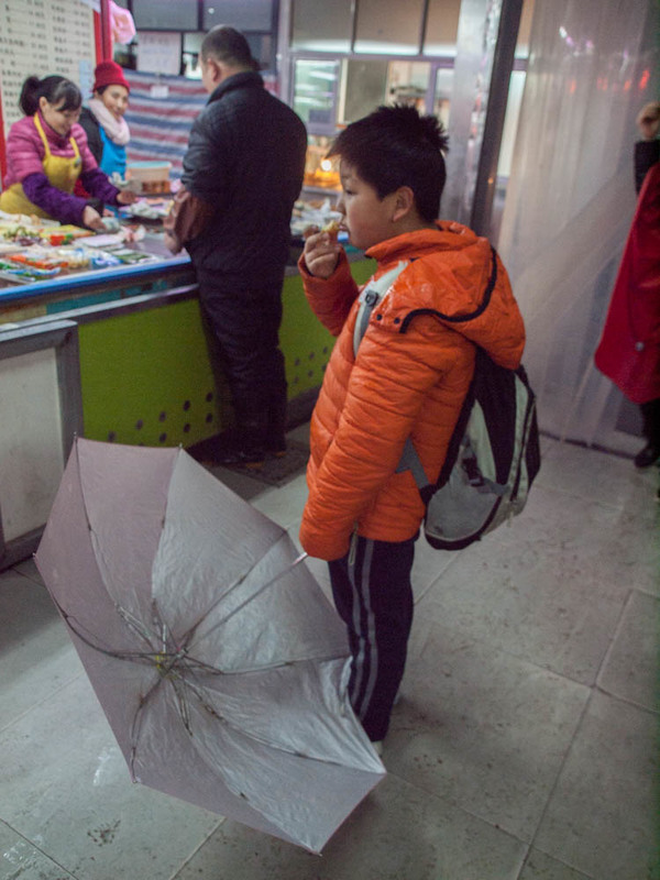 "A boy drying off in the Wet Market in Shanghai<a href=""/reason/images/601675_orig.jpg"" title=""High res"">∝</a>"