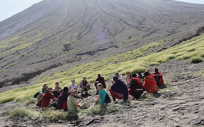 Students enjoying a rest below one of the many mountains in Tanzania.
