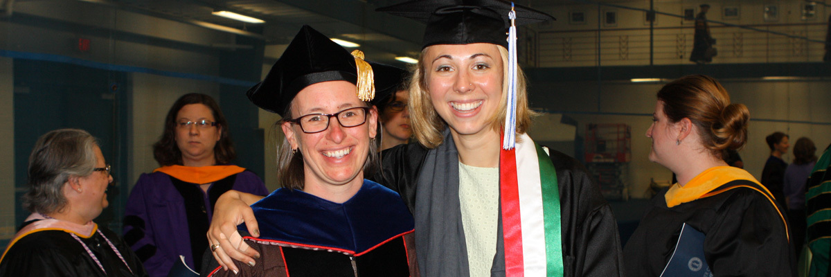 Laura Peterson and Katherine Huska '15 pose for a photo.