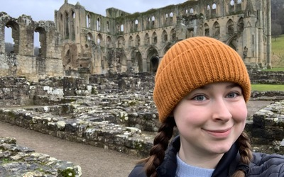 A Selfie of me with Rievaulx Abbey's ruins behind me.