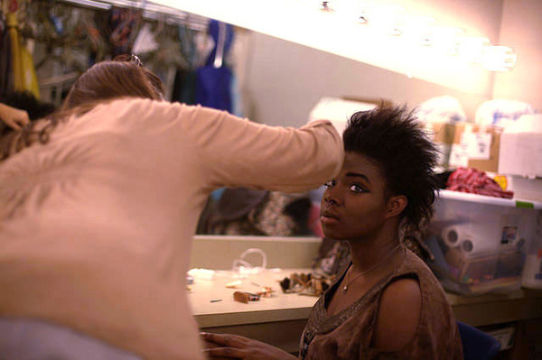 Luther student doing makeup for the Luther Theatre production of A Thread in the Dark.