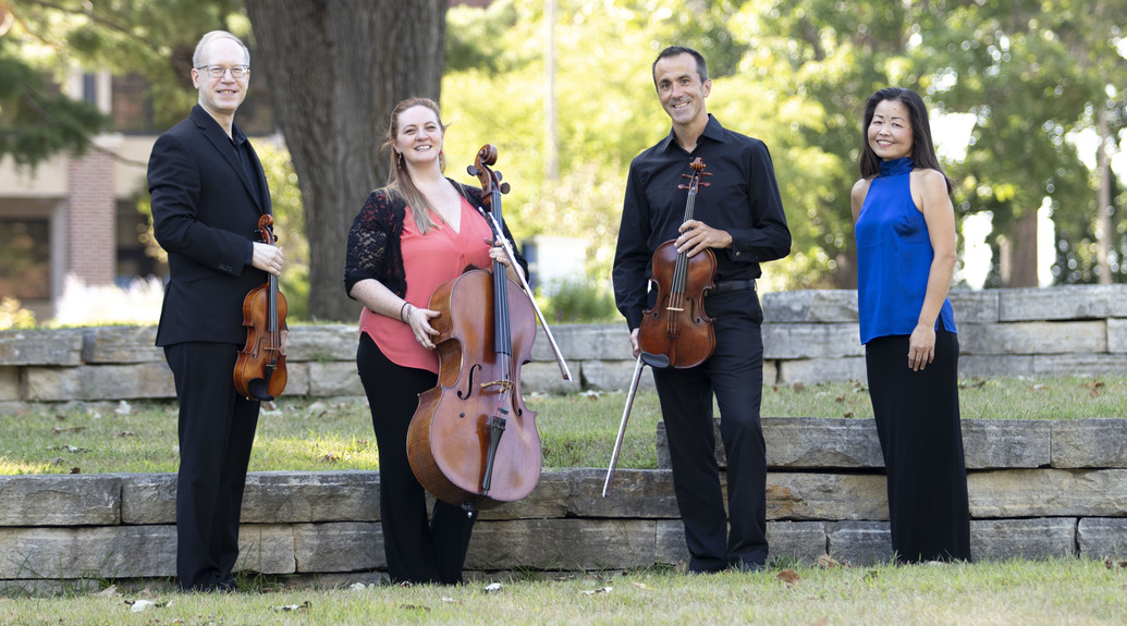 The four members of the Luther College Piano Quartet.