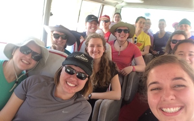 Windy, sweaty group selfie on the bus to Arusha