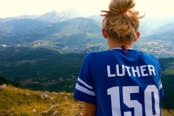 Luther student gazing at vista while studying abroad.