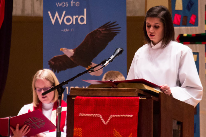 A student reads from the Bible during weekly chapel