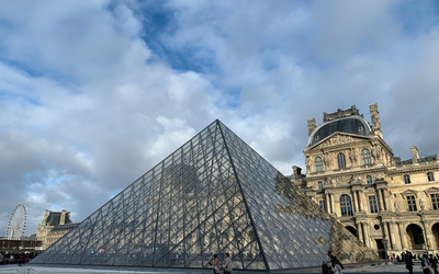 The glass pyramid at the Lourve in Paris, France
