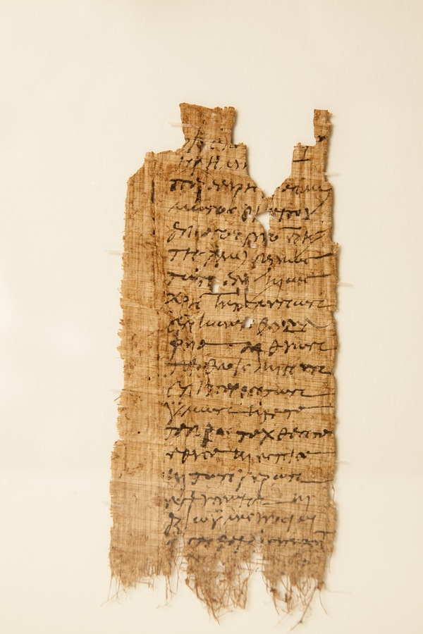 "P.Luther 4: Decian Libellus, Theadelphia, ca. 12 June – 14 July, 250 CE (Front) - This papyrus is an example of a ""Decian Libellus,"" a certification of sacrifice according to the empire-wide decree of the Roman emperor Decius (ruled 249-251 CE). About 45 of such libelli are known today and most of them, including this example, were issued to residents of the village of Theadelphia. This concentration has prompted speculation that the Theadelphia examples come from a single large discovery in this village, which was thereafter dispersed on the antiquities market. This libellus was submitted by a man named Aurelius Sarapammon, who says that he has ""sacrificed, poured the libations, and tasted the offerings,"" in accordance with the decree. His claim is certified by two local officials who were in charge of administering these official sacrifices. Aurelius Sarapammon was the servant of Aurelius Appianus, a well-known aristocrat from the provincial capital of Alexandria. Appianus had many estates in the Fayum and we know from other texts that Sarapammon was a donkey driver who worked on his estate in Theadelphia. Translation: ""To those who have been selected to take charge of the sacrifices, from Aurelius Sarapammon, servant of Appianus, former exegetes of the most-illustrious city of the Alexandrians, and however he is styled, residing in the village of Theadelphia. Always sacrificing to the gods, now too, in your presence, in accordance with the orders, I sacrificed, poured the libations, and tasted the offerings, and I ask that you sign below. Farewell. (2nd hand) We, Aurelius Serenus and Hermas [saw you sacrificing …"" (Description and translation courtesy of W. Graham Claytor, University of Michigan)"