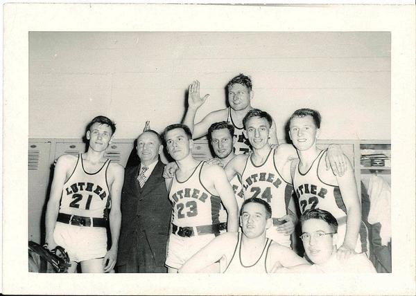 "The Luther College basketball team won the Iowa Conference championship in 1949 and again in 1954. Shown here are players from the 1949 team. ""Of competitive sports the faculty stated in 1954: 'We believe that athletic competition under proper administration is a constructive and satisfying part of student life for both participants and non-participants. We strongly resist both the tendency to abandon so desirable an element in the development of a well-rounded student and also the tendency to engage in any practice which we recognize as educationally unsound.' … One inspector wrote: 'There are no athletic scholarships; yet the football record of 20 wins in 2 1/2 years is the second highest among the smaller colleges of the Middle West.' The record in other sports is also impressive, as in 1954, when the college won an Iowa Conference football championship, a basketball championship, a tie for the championship in wrestling, a championship in tennis, a championship in the Northern Division in track and field, and a tie for the championship in the Norther Division in baseball."" [Luther College 1861-1961, David T. Nelson, p 337]<a href=""/reason/images/469711_orig.jpg"" title=""High res"">∝</a>"