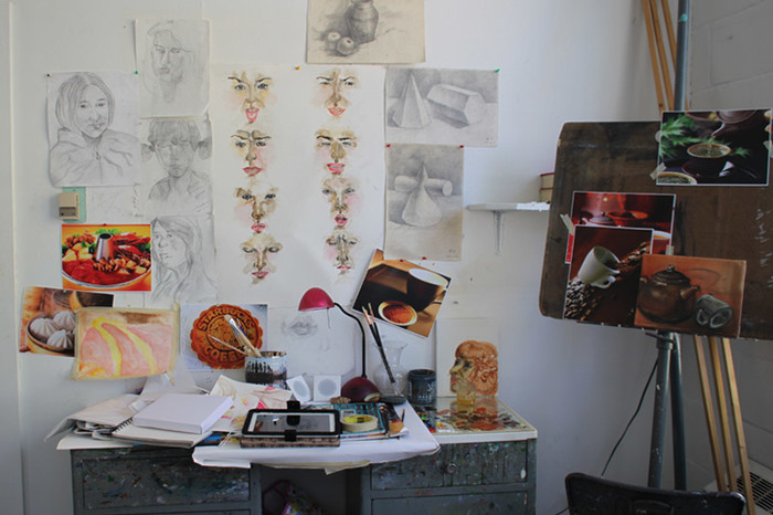 A student studio space in Korsrud with artwork on display.