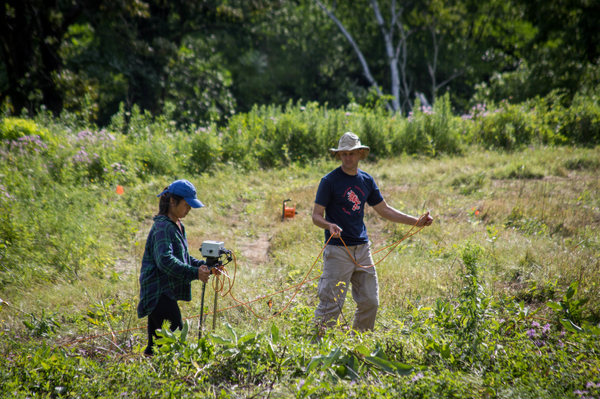 "Betts and student studying effigy mounds<a href=""/reason/images/883755_orig.jpg"" title=""High res"">&prop;</a>"