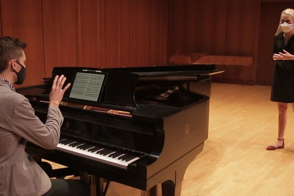Vocal Coach Nicholas Shaneyfelt working with a vocalist in the Noble Recital Hall.
