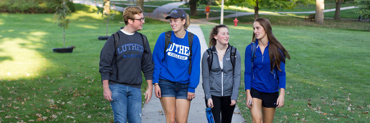 Students walking together on Luther campus.