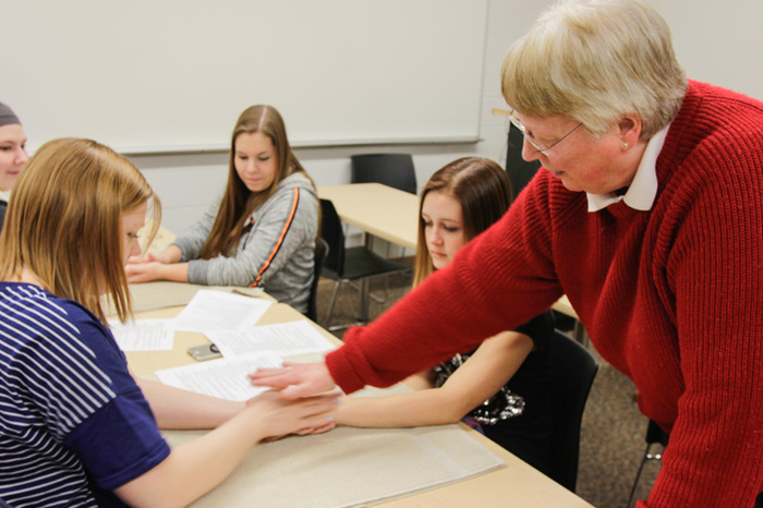 "Jacki Wright's ""Exploring Alternative Medicine"" J-Term class learns about pressure points hands."