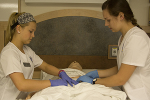 Nursing students participating in the wound care lab.