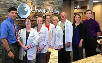 Luther sophomore Phillips, pictured right, at his summer internship with Oneota Valley Family Eye Care.