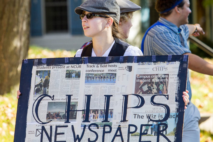 A Luther student holds a CHIPS sign during the homecoming parade