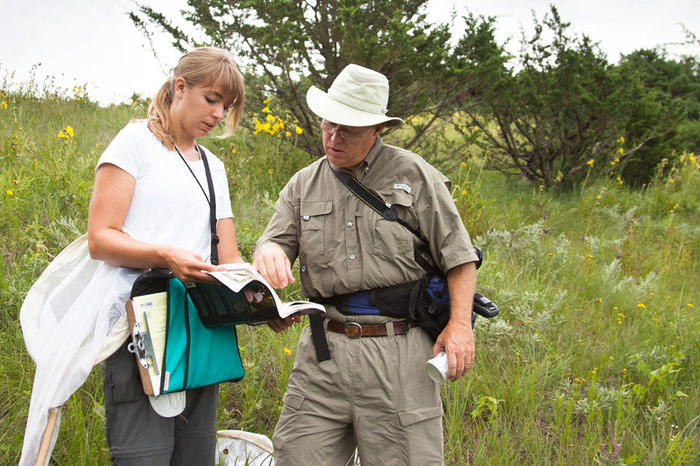 Professor Kirk Larsen with a student conducting research in Luther's natural areas