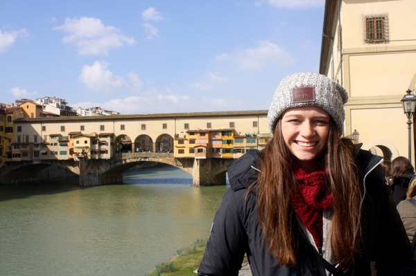 "Erin Hocker in front of the Ponte Vecchio in Florence<a href=""/reason/images/805811_orig.jpg"" title=""High res"">∝</a>"