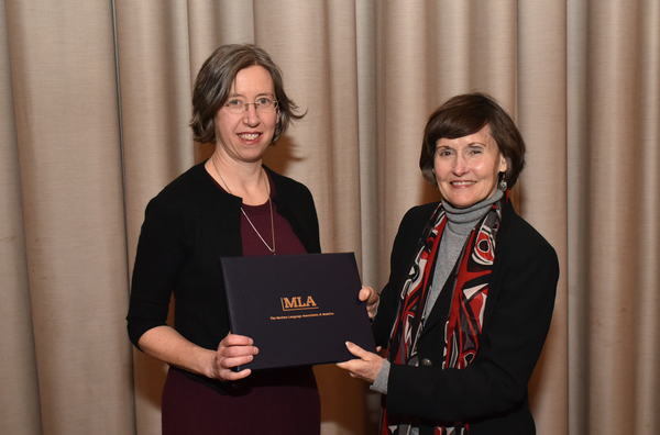 "Nancy Gates Madsen receiving the Modern Language Association's Katherine Singer Kovacs Prize from Anne Ruggles Gere, MLA first vice president. (Photo by Edward Savaria, Jr.)<a href=""/reason/images/802821_orig.jpg"" title=""High res"">∝</a>"