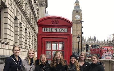 Ashley, Jessica, Sara, Addy, Mikayla, Morgan, and Andrea in front of a British phone booth and Big Ben.