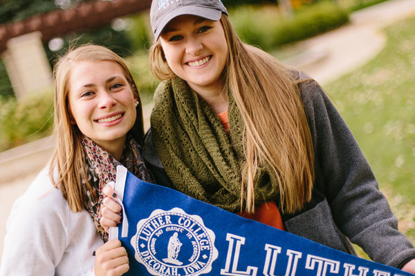 Students holding a Luther pennant.