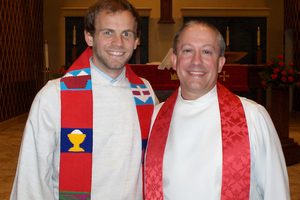 Justin Tigerman '11 posing with his adviser Sean Burke at Justin's ordination service.