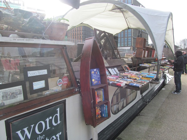 "A floating book shop on a canal in London.<a href=""/reason/images/602850_orig.jpg"" title=""High res"">∝</a>"