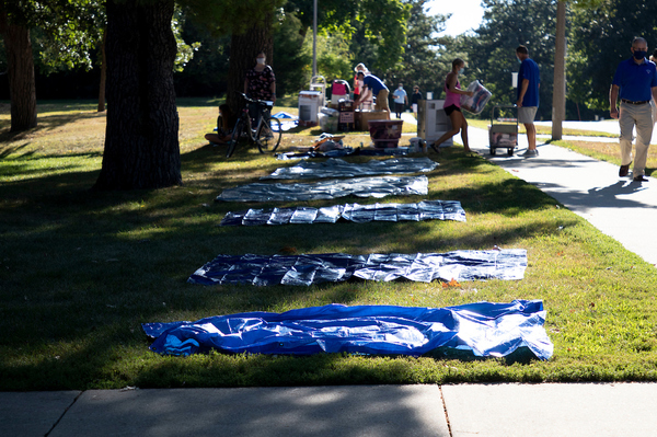 Tarps placed to help students and families safely distance while moving in