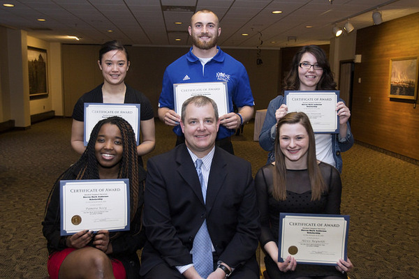 "Celebrating with Stuart Anderson (front center), whose family established the Steven Mark Anderson Scholarship, are Luther students and 2014-15 scholarship recipients: (front row) Pamera Kezy, Alexis Reynolds, and (back row) Jessica Edgar, Alex Hain, and Kathleenjo Peterson. The winners were announced during the 2014 Student Support Services celebration banquet.<a href=""/reason/images/542857_orig.jpg"" title=""High res"">∝</a>"
