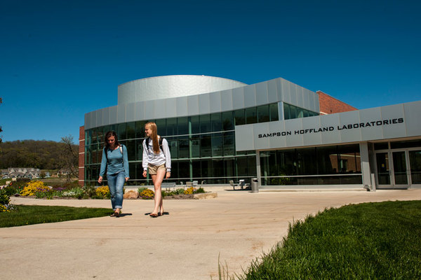 Students walking in front of Sampson Hoffland Laboratories.