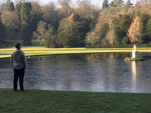 Joe looking out over the pond at Fountains Abbey and Studley Royal