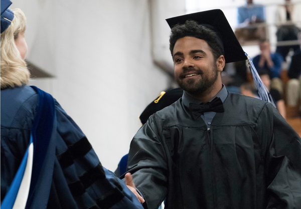 "Charlie Mitchell, Luther College class of 2017, at the 2017 Commencement ceremony.<a href=""/reason/images/765875_orig.png"" title=""High res"">∝</a>"
