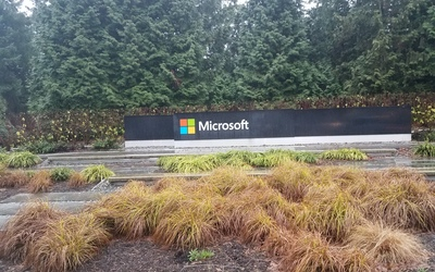 Microsoft sign sitting on the end of campus