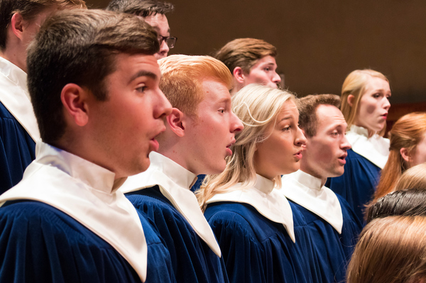 A close-up photo of a few Nordic Choir members.
