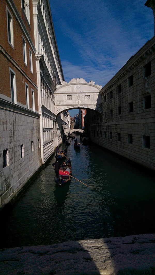 The Bridge of Sighs - On the left, the Doge's Palace. On the right, the Prison. In the old days, once you go over the bridge, you never came back.