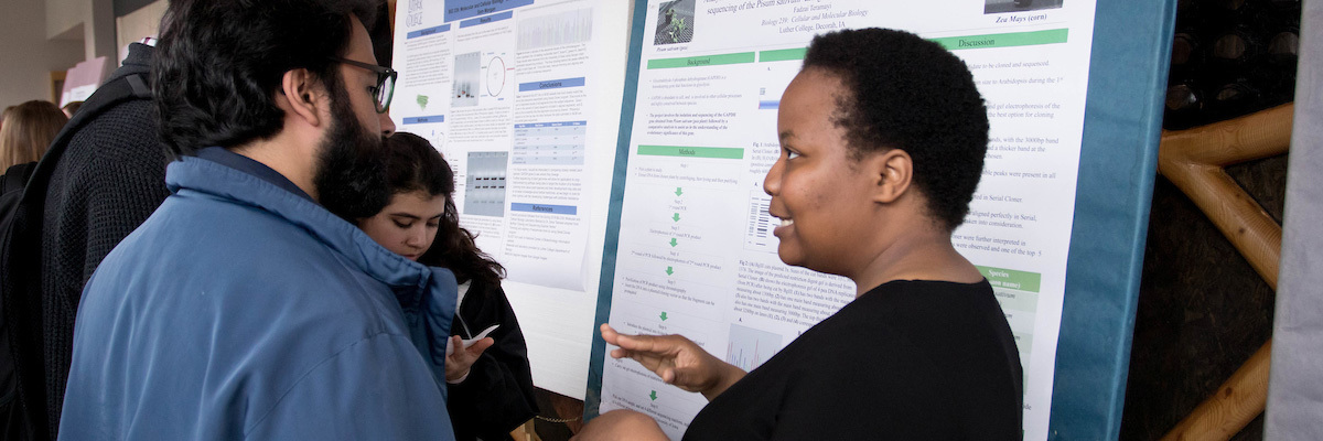 Students presenting at the annual research symposium.