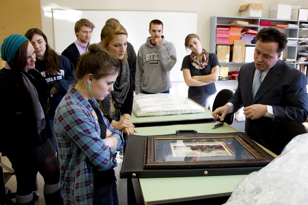 Art History students examine original work with visiting scholar.