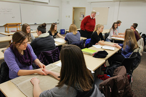 Students learn about hand pressure points in the Exploring Alternative Medicine course.