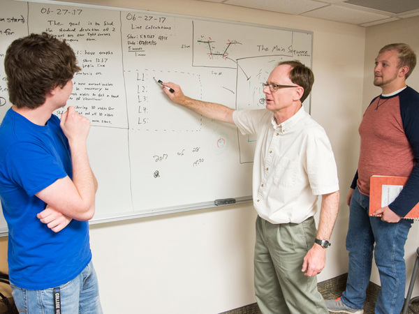 Professor Wilkerson conducting research with students (left) Erik Floden ('18) and (right) Torger Jystad ('19)