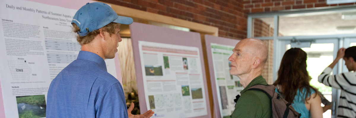 A student presenting their research at the research symposium.