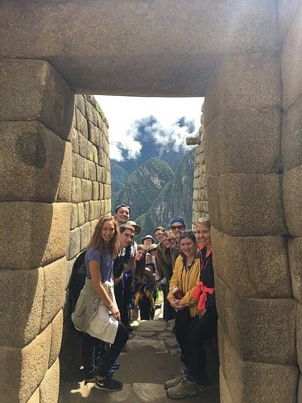 The crew in a passageway in Machu Picchu