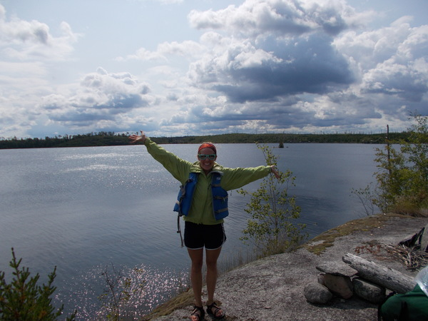 A Luther student enjoys sunny weather by the Boundary Waters.